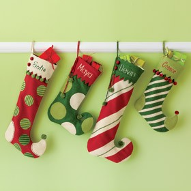 Windows are a fun place to hang your stockings. String them from the top of the window frame, hang them from your window locks, or from weighted stocking holders. When hanging your stockings by the window, do so with care (in the hopes that St. Nicholas soon will be there!).